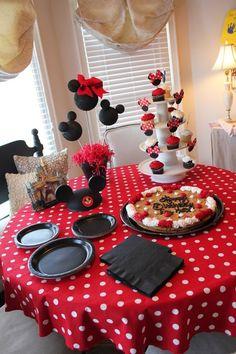 Love the table setup!  table cloth, plates set up like mickey, cupcake tree, etc.