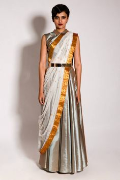 This ensemble features a gorgeous upada silk floor length pleated skirt paired with a matching collared cropped choli. The ensemble is completed with a white net dupatta embellished with gold zardozi butis and a gold kanjivaram border. Lehenga Designs, Saree Blouse Designs, Dress Indian Style, Indian Dresses, Indian Outfits, Indian Clothes, Pakistani Dresses, Neeta Lulla, Saree Draping Styles