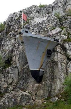 Abandoned Military Base In Murmansk, Russia. How would they get that stone mountain to eat that steel ship?