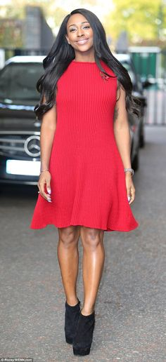 Sending a positive message: Alexandra Burke was all smiles as she left the ITV studios in London on Monday morning following a joint appearance on Good Morning Britain with her motherMelissa Bell