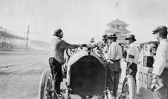 Jules Goux congratulates Barney Oldfield following the 1914 Indy 500.