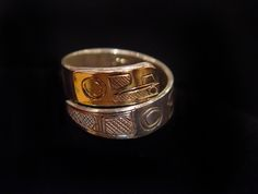 Raven Ring 2, Terrance Campbell, Tahltan. Sterling silver, 14 k gold, wrap style. First Nations Jewelry.
