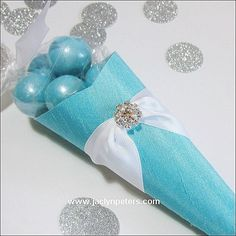 Our elegant favor cones in Tiffany Blue are an elegant way to package confetti, candy or thank you gifts at your wedding or special event. Each is handmade to coordinate with your table decor! Your gu