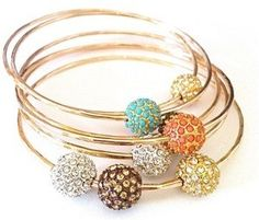 pretty bangles! Love these. But I'm sure my wrist is too small. : (