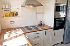 Ikea kitchen: Adel units with walnut top - Moregeous Design