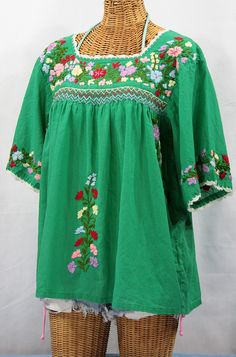 Green peasant top, Mexican style; hand embroidered with ivory crochet trim.