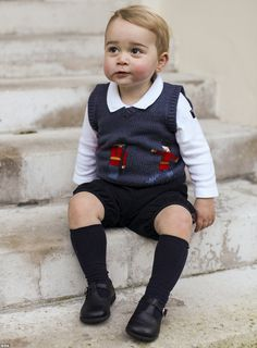 Mail Online. He has been crowned 'His Royal Cuteness'.  Looking remarkably like his father William when he, too, was a toddler, George grins for the cameras, showing off the dimples he has inherited from his mother and more than a hint of his mischievous character.   Read more: http://www.dailymail.co.uk/news/article-2872867/He-s-Gorgeous-Prince-George-proudly-poses-soldier-jumper-adorable-Christmas-portrait.html#ixzz3Lr3rLKk3  Follow us: @MailOnline on Twitter | DailyMail on Facebook