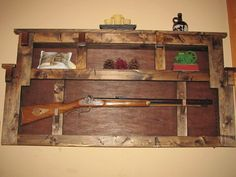 Rustic Gun Rack Plate display wall shelf by NCCOUNTRYCRAFTERS, $375.00 A MOST DEF FOR CLAYTONS PLAY ROOM/MAN CAVE :)