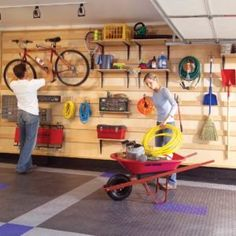This garage wall hanging storage system makes every inch count. You can easily store all kinds of tools, bikes, garden equipment and even add shelves and bi Garage Ceiling Storage, Wall Hanging Storage, Garage Storage Shelves, Sliding Shelves, Garage Storage Solutions, Garage Walls, Garage Cabinets, Basement Storage, Garage Organization