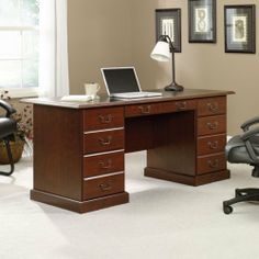 Sauder Executive Office Desks by Sauder. $379.98. This executive desk has a flip-down drawer front that reveals a slide-out keyboard/mouse shelf with metal runners and safety stops. Three file drawers hold letter, legal or European size hanging files. Two file drawers on left lock for security. Two small drawers feature metal runners with safety stops. Black melamine top is heat, stain and scratch-resistant. Quick and easy assembly with patented T-slot drawer system....