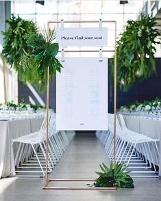 WEBSTA @ state.of.reverie - The seating chart in full frontal. Custom made from copper, this baby works a treat as a frame to my seating chart and leather straps. Available to hire from August. • Amazing tropical florals and foliage by @secret_blossom • Rigging by @technical_events • Chair hire @placesettings • Linen @tablearteventhire • Venue @altoeventspace • Catering @dammfinefoodgroup • Photo by @alexpomnikow • All stationery by me  #revgoesgreen