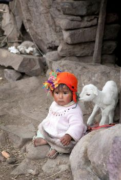 Peruvian baby in the high Andes by Katina Houvouras
