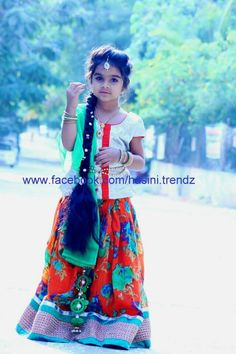 Just cute in langa blouse ........