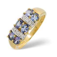 Diamond Essentials 0.96 Ct Tanzanite and 0.03 Ct Diamond Ring In 9 Carat Yellow Gold From the Diamond Essentials collection in 9 Carat Yellow Gold. Ladies. Presented in a Contemporary hardwood gift box. Our price: pound