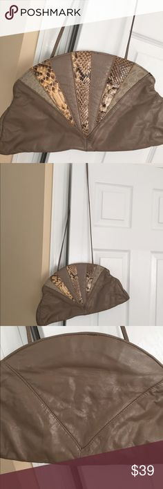 Beautiful taupe leather and skin shoulder bag 😄 Beautiful taupe leather and python skins bag. Can be used as a shoulder bag or clutch. Very roomy. In good condition. Stain inside, as shown. Clasps shut! Bags Shoulder Bags