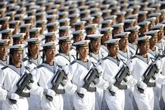 """""""The Chinese Art of the Crowd"""" by The Atlantic   Members of the Chinese People's Liberation Army Navy march in formation during a training session at the 60th National Day Parade Village on the outskirts of Beijing, on September 15, 2009.   photo: Joe Chan / Reuters"""