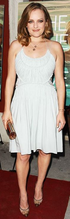 Who made Elisabeth Moss' dress, gold clutch, and lace pumps