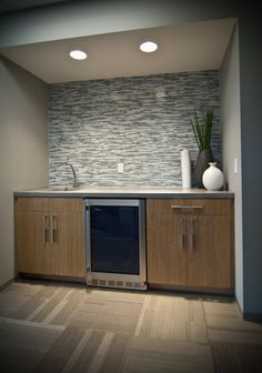 Mosaic backsplash and light #cabinets give an #office a warm and welcoming feel. #commercial