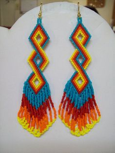 Native American Style Beaded Twisted Earrings in Turquoise, Red, Orange and Yellow Delcia Beads Sout Seed Bead Jewelry, Seed Bead Earrings, Beaded Earrings, Yellow Earrings, Beaded Jewelry, Angel Earrings, Silver Earrings, Silver Jewelry, Jewellery