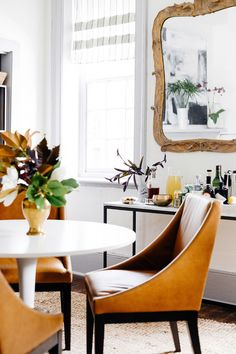 I like the mirror in the background, gives it a bohemian vibe. The console table underneath provides extra workspace.