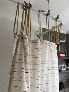 The Bathroom Had A Rustic Nautical Feel Shower Curtain Was Hung From Ceiling Fixture By Coated Outdoor Rope And Galvanized