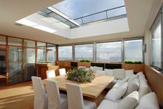 Parisian penthouse with a retractable ceiling in the dining room.