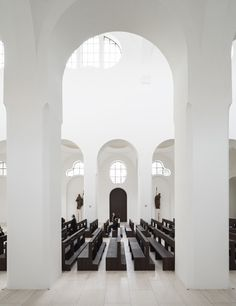 | Contrast between the pure white interior and the dark wood accents, renovation of the St Moritz Church | John Pawson
