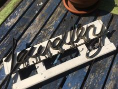 Upcycled project. Gave the sign a crackle glaze makeover and attached it to a piece of vintage potato crate (which I painted). Going to use this to display the jewellery I make.