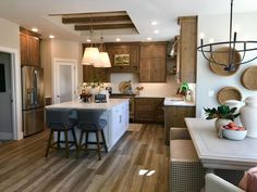 Love the layout of this kitchen. No sink in the island! Kitchen cabinets to ceiling. Dark cabinetry with White Island. Two seats in island. Kitchen open with large dining area and living room. This home is for sale in Cedar City, Utah. Call The Matt Bagley Team at ERA Realty Center 435-865-1019.