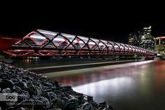 Peace Bridge - Pinned by Mak Khalaf Calgary night time cityscapes City and Architecture albertaarchitecturecalgarycanadacitycityscapecustomhdrlong exposurenightnight photographynightscapeoutdoorsyyc by MIKEWELLSPHOTO