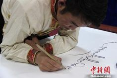 Pinterest Pin - Master artist strives to preserve Tibetan calligraphy writing.