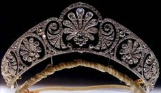 Queen Mary's honeysuckle diamond tiara is decorated with a graduated frieze of styled honeysuckle.  It was compiled from deconstructed jewels, which included existing diamonds, largely those taken from the dismantled Surrey Tiara, plus new stones supplied in the making of the tiara (it was made by E. Wolff & Co. for Garrard, circa 1913-14).  The central ornament was made to be detachable so Queen Mary could set it with a large stone (the Cullinam V diamond, a pink topaz or a sapphire/diamond…