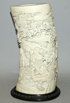 A quality signed Japanese Meiji period ivory tusk vase, the side with an engraved signature. Est. £4,000-£6,000.