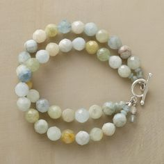 SEVEN SEAS BRACELET -- Faceted spheres of amazonite and aquamarine reflect the many and varied hues of oceans the world over. Two strands join with sterling silver toggle. Handmade for us in USA. 7-1/2L.