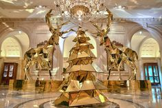 Electric Light Bulb Christmas Tree and Golden Reindeer at Four Seasons Hotel George V Paris - Pursuitist
