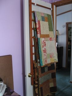 Side of an old crib hung on the back of the door. Good idea. This site has tips for organizing your sewing room.