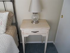 My first project was my old Singer sewing cabinet that I painted with homemade chalk paint, distressed it and now it serves as a side table in the guest room.