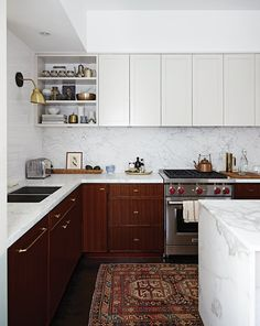 When H&H editor-in-chief Suzanne Dimma and her husband, designer Arriz Hassam of arriz+co, bought their charming downtown Toronto Victorian, it had a lot of potential — and needed a lot of work. Their budget wouldn't cover a total kitchen renovation, so they made a few immediate and high-impact changes: the cherry upper cabinets were removed, laminate …