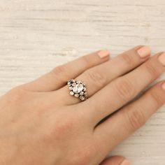 Erstwhile Jewelry, antique oval engagement ring, floral side stones, rose cut.