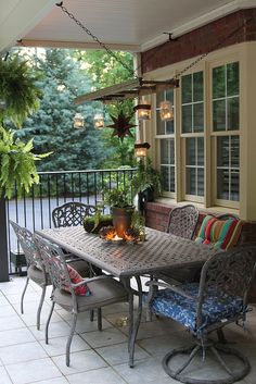Love this porch with mismatched pillows and hanging lanterns!  by Unskinny Boppy, via Flickr