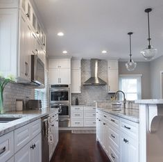 The Gramercy style cabinetry's raised panel design, dovetail drawer boxes, full extension soft closing drawers, and soft closing doors. Interested in learning more? See the link in the bio to learn more about our #cabinetry lines. . #TesiDesignInc -- Interiors & Cabinetry is a proud dealer of #Forevermarkcabinetry. #KitchenDesign #kitchencabinetry #whitekitchen #doorstyle #doors #kitchenisland #kitchenlighting #forevermark #forevermarkcabinetry