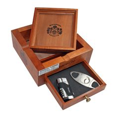 "This set includes: 1 Macanudo Ashtray 1 Stainless Steel Big Ring Cigar Cutter 1 Double Torch Lighter Pull out drawer Removable ashtray  dimensions: 7"" x 7"" x 3"""