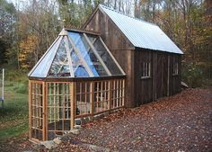 Green house attached to barn. Nearly all the materials are recycled, including the glass. The wood for the windows came from old 2x4's.