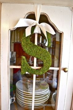 Pottery Barn Inspired. So easy: buy wood or foam letter, cover with glue & thin layer of moss. Cute! @ DIY Home Cuteness
