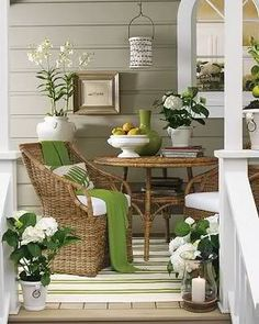 absolutely love this....front #patio - use wicker or rattan, lots of greenery and sage green accents to bring a natural look and feel to a small cozy outdoor space. Love the attention to detail.