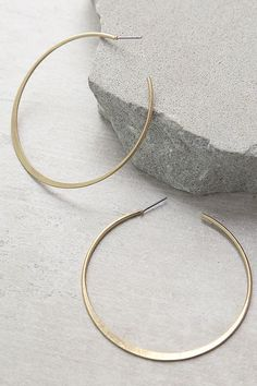 "You'll transform into the goddess you are in the Alter Ego Gold Hoop Earrings! Simple and lightweight matte gold hoop earrings are lightly antiqued. Earrings have a 2.25"" diameter."