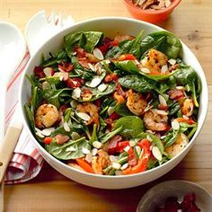 Shrimp and Spinach Salad with Hot Bacon Dressing Recipe -I meet a couple former co-workers for lunch at our favorite restaurant and we always order this salad. I wanted to share it with my husband, so I made it my mission to re-create it. Mission accomplished! —Lisa Bynum, Brandon, Mississippi
