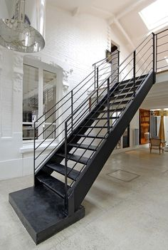 Fabrice Ausset modern interiors- these are not your every day stair case , i like that !