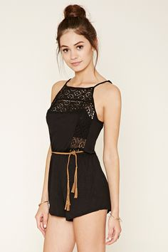 A slub knit romper featuring adjustable cami straps, a crochet-paneled front, a square neckline, a tasseled self-tie belt at its elasticized waist, and slanted front pockets.