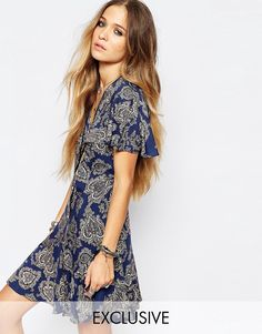 Image 1 ofReclaimed Vintage Button Front Mini Tea Dress With Ruffle Detail In Paisley Print
